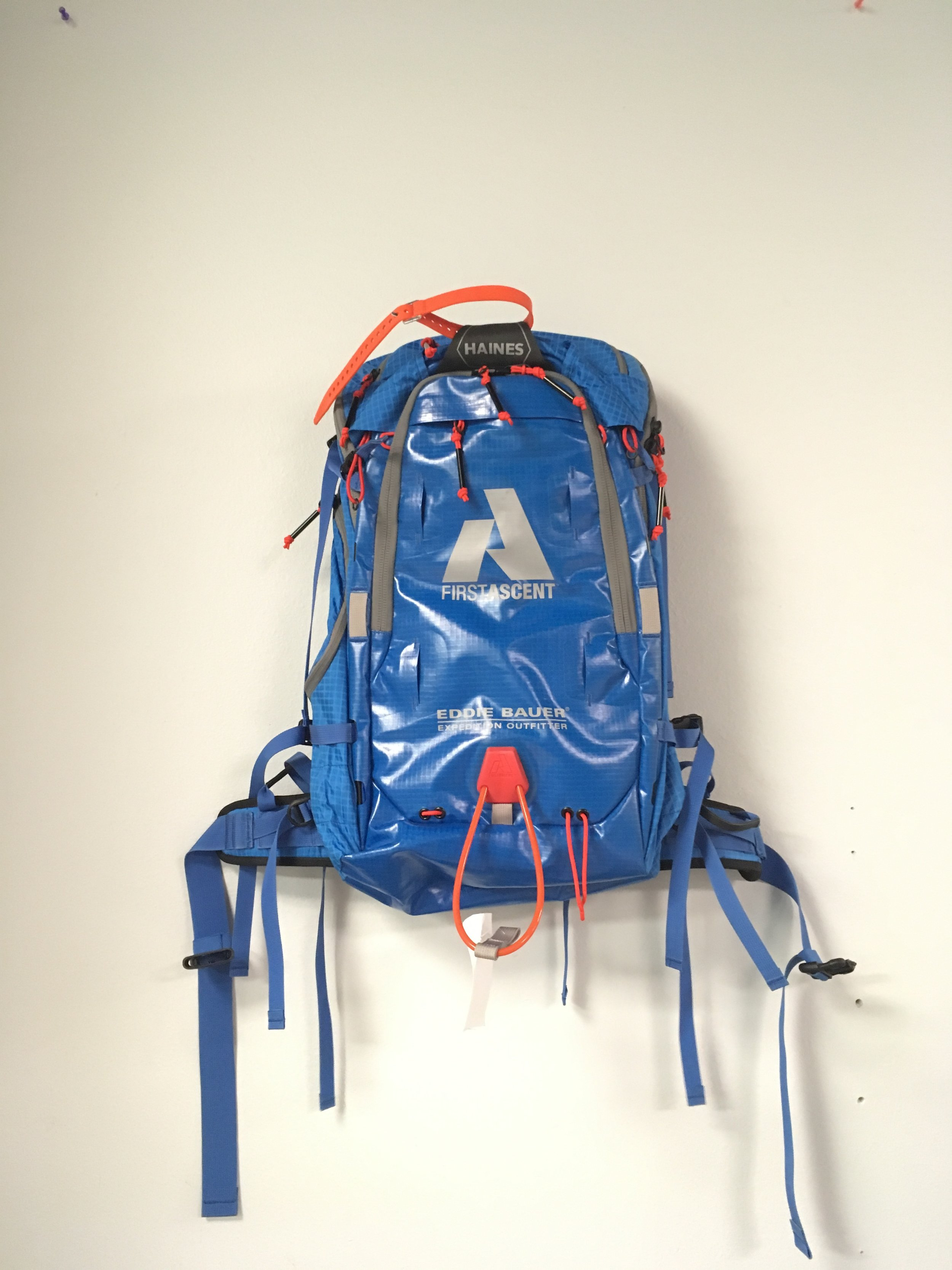 Need a burly winter pack? We have you covered with Eddie Bauer's Haines backpack. Features include:  - A frame and vertical ski carry systems that are fully adjustable for any ski size - 35 liter main compartment expandable to 45 litres - Sheaths for probe, shovel and handle – easy/quick access to avy gear - Retractable Ice axe carry loops - Lined front pocket for keeping wet skins away from dry gear - Side and top access to main compartment - Removable aluminum pack frame  MSRP for the backpack is $249 but we have it at $129!