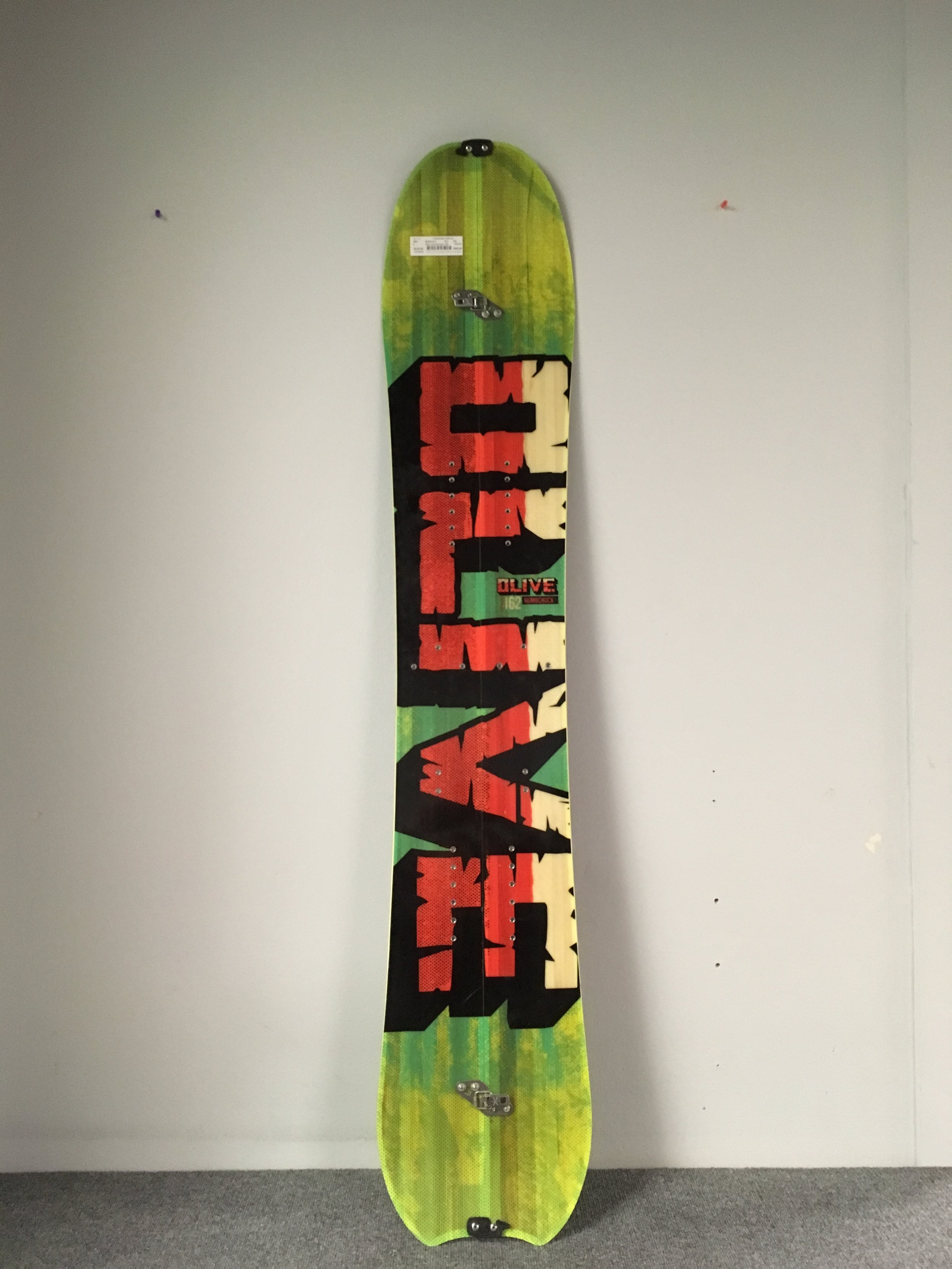 """The 162 Olive Numbchuck is definitely one of the coolest split's we've seen come in all winter. The dudes from North of the border have this to stay about the board, """"A small board with a big punch. the numb chuck is a directional split powder board with kungfu kicks. poplar core, reinforced with ash and triaxial composites to provide a stiffer feel. all mountain shape with rocker for a fluid powder ride. locked tight with karakoram tip + board clips. hiya!go climb a mountain, save your money for beer."""" I think they're spot on! Retail on this bad boy is listed at $985 but we can get you out there for $549!"""