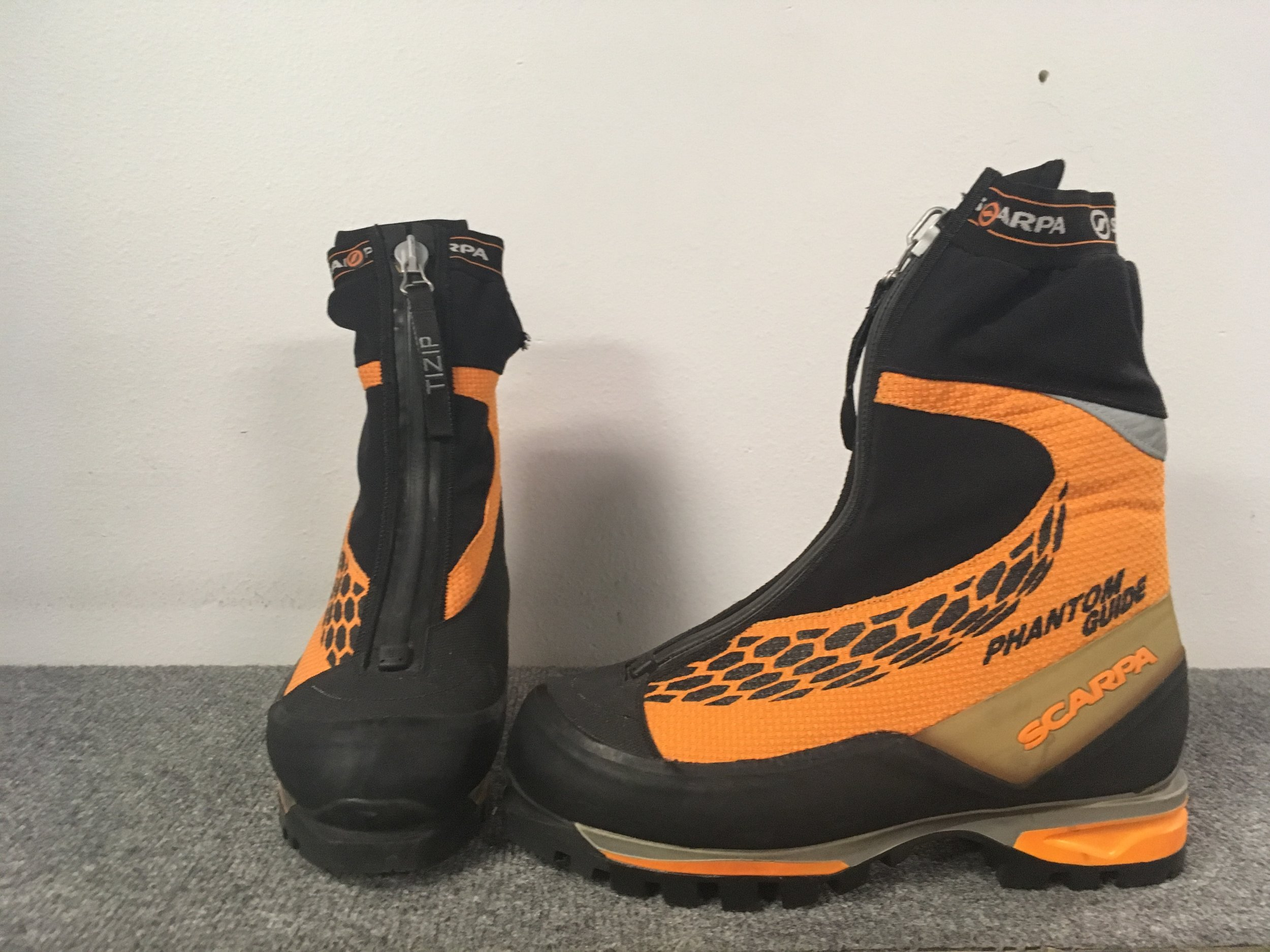 Climb high and stay warm and dry with Scarpa's Phantom Guide boot! Featuring 200 grams of primaloft insulation, Vibram soles, and TIZIP waterproof zippers the Phantom is virtually bombproof. Retail for the pair is listed at $629 but we can get you climbing for $274! The size is a Euro 42.