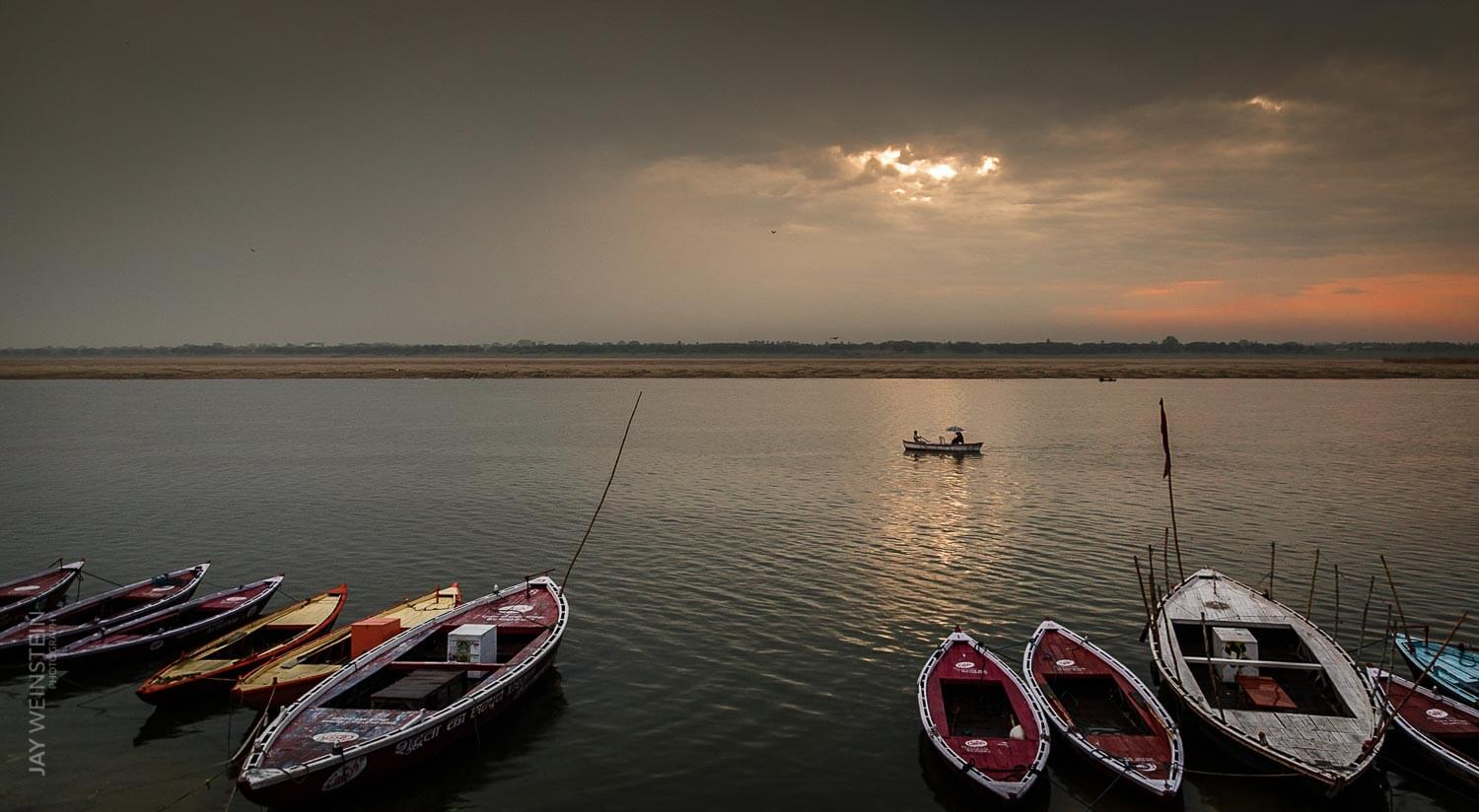 The sun rises over the Ganges River in Varanasi, Uttar Pradesh.