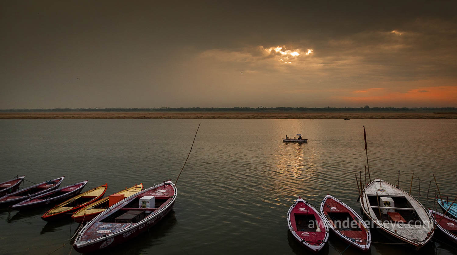 The sun rises over the sacred Ganges river in Varanasi.