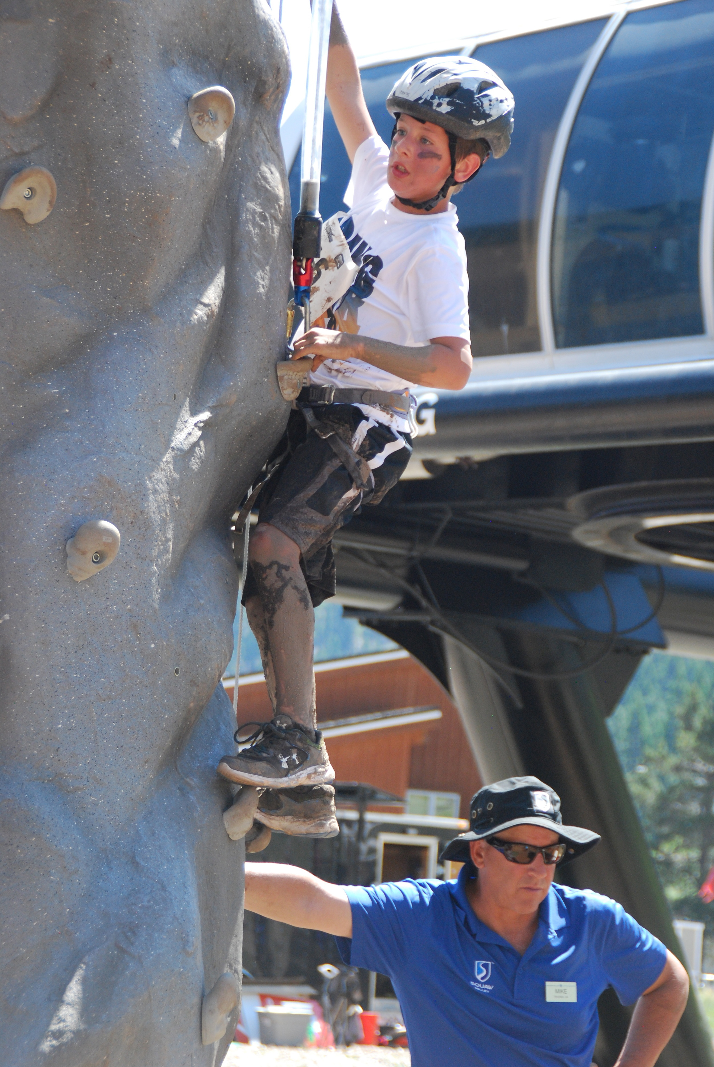One BGCNLT participant tackles the challenge of the rock climbing wall