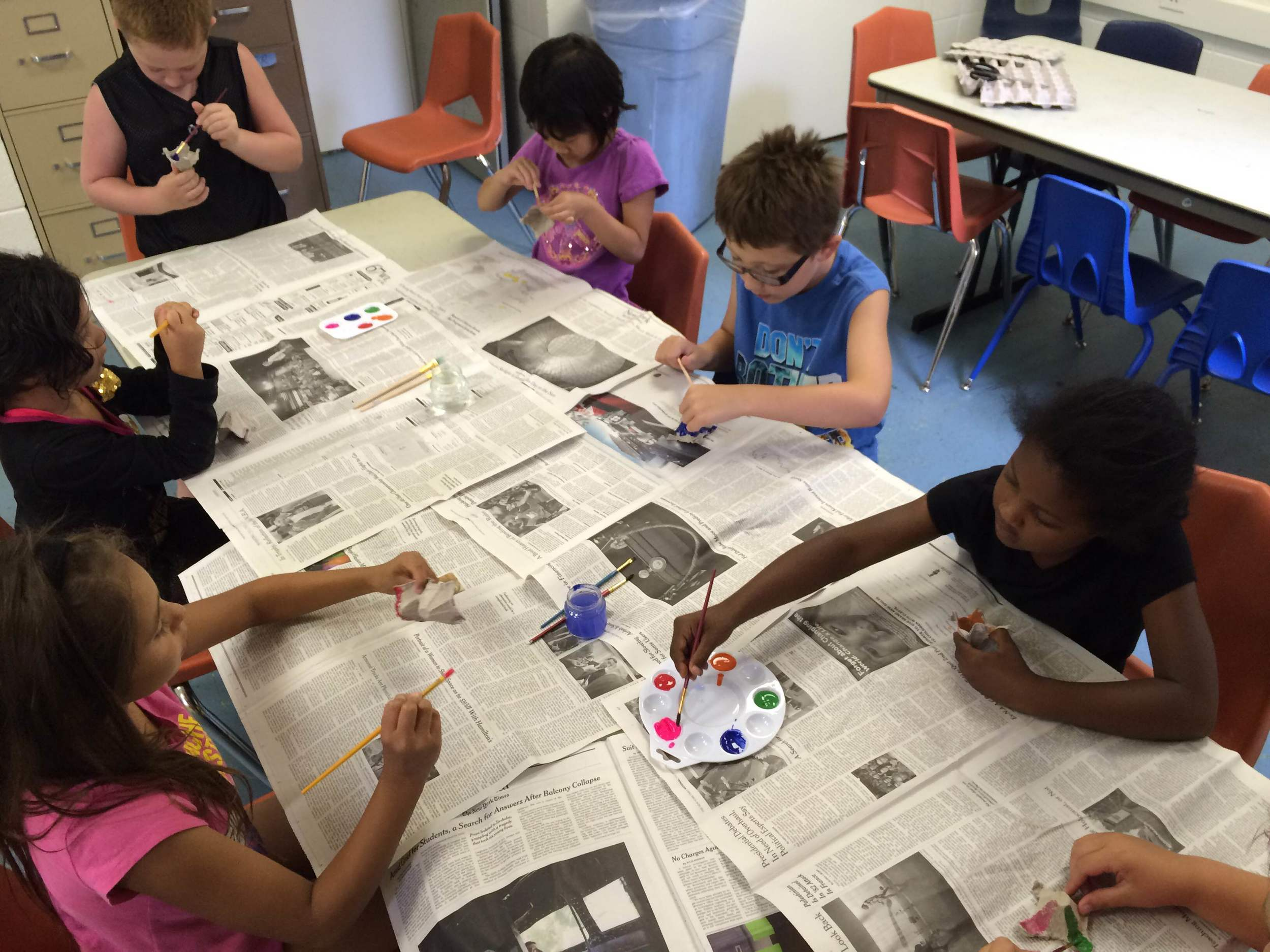 The children spent one of their first lessons decorating and personalizing their egg carton pots