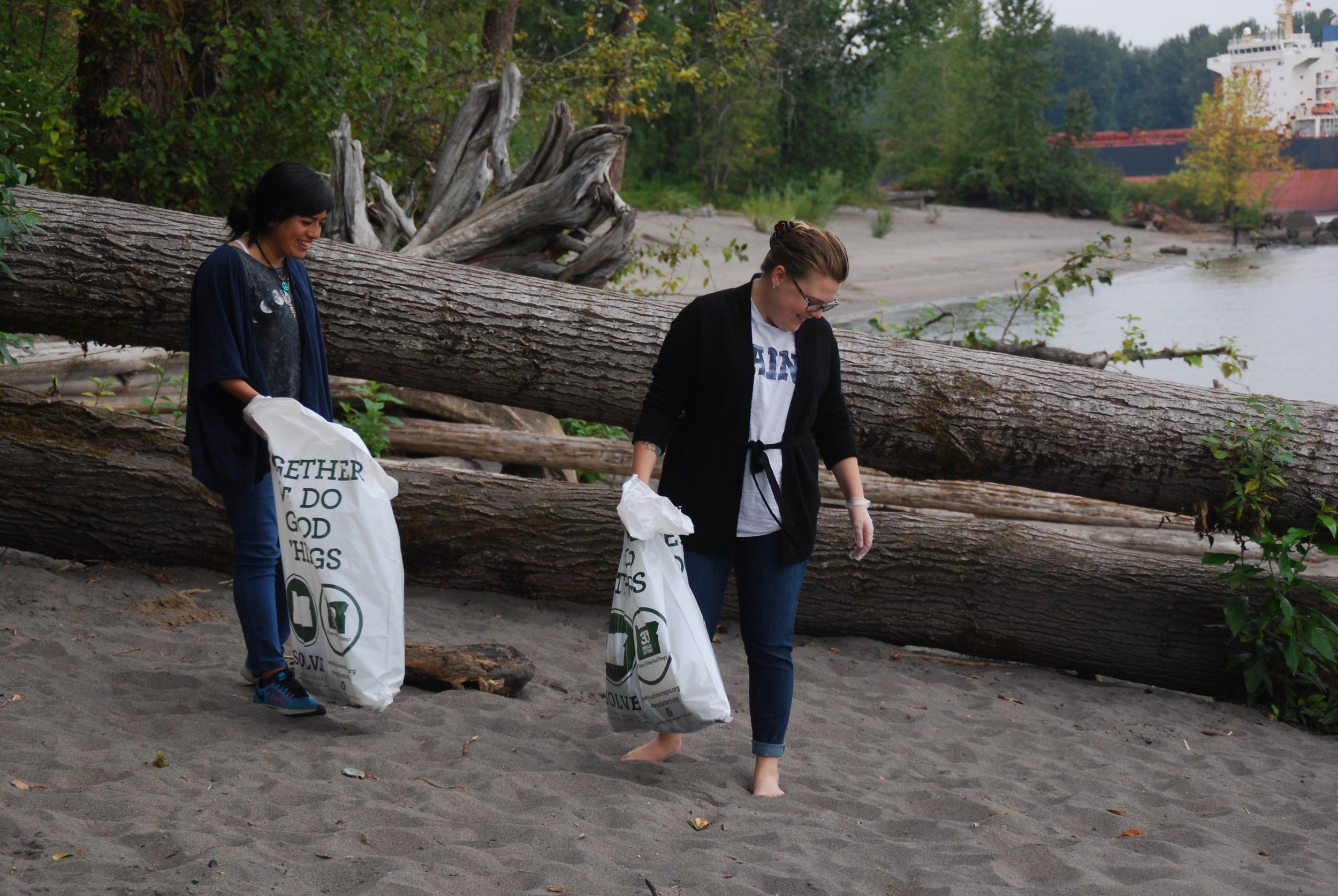 Fellows, Rina and Emma collecting litter along the shore