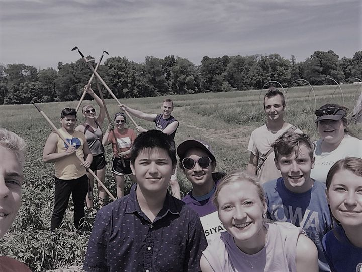 Brianne and members of SIYAC helping harvest food for local communities around Iowa for Feed Iowa First.
