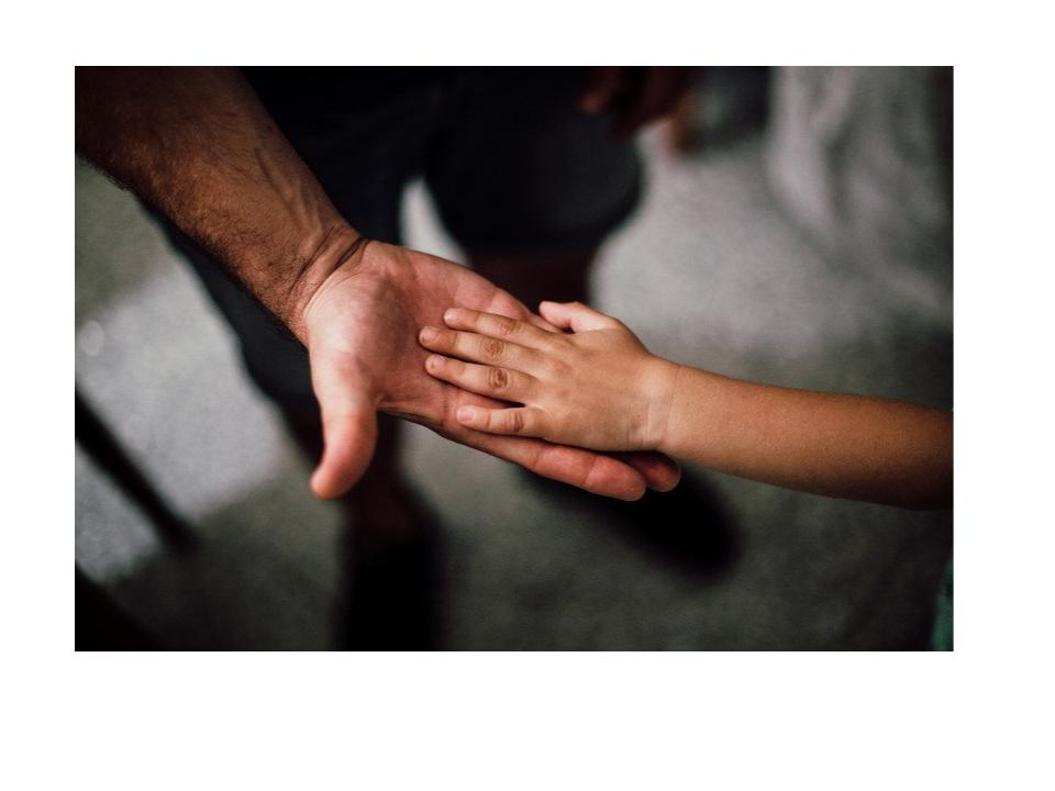 child's hand placed on top of adult's hand.jpg