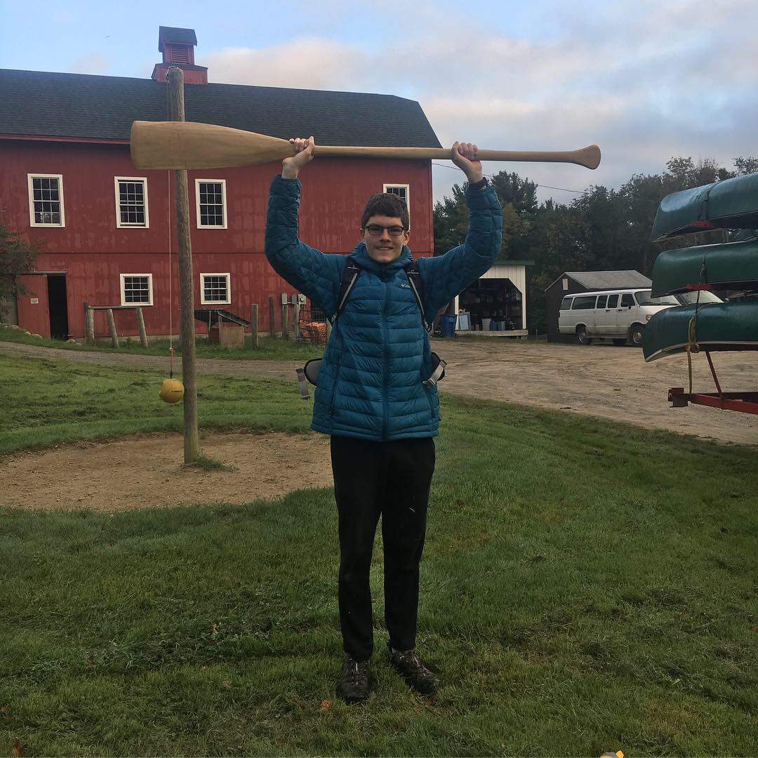Dan standing proud with his hand-crafted wooden paddle!