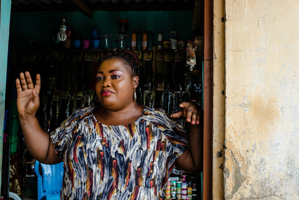 Adjo Aklikoko, 39, is married with three children aged 17, 14 and 9. Her business is a small shop that sells plastics bowls and wigs. With it she supports her immediate family, as well as her siblings.
