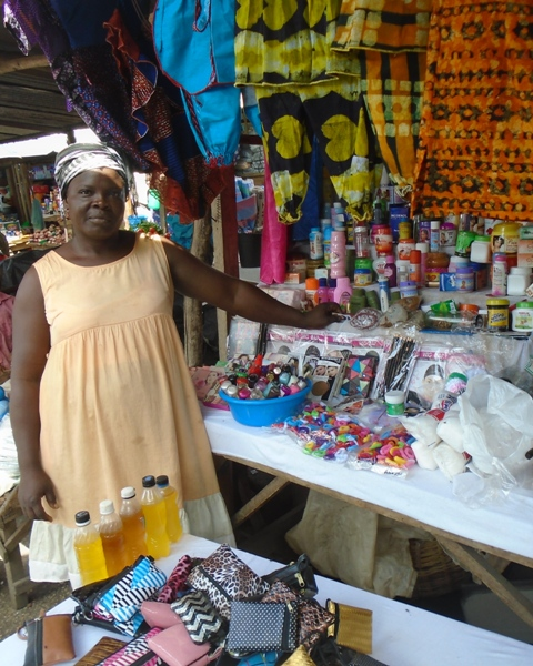 Adzo using her first loan to open her first market stall