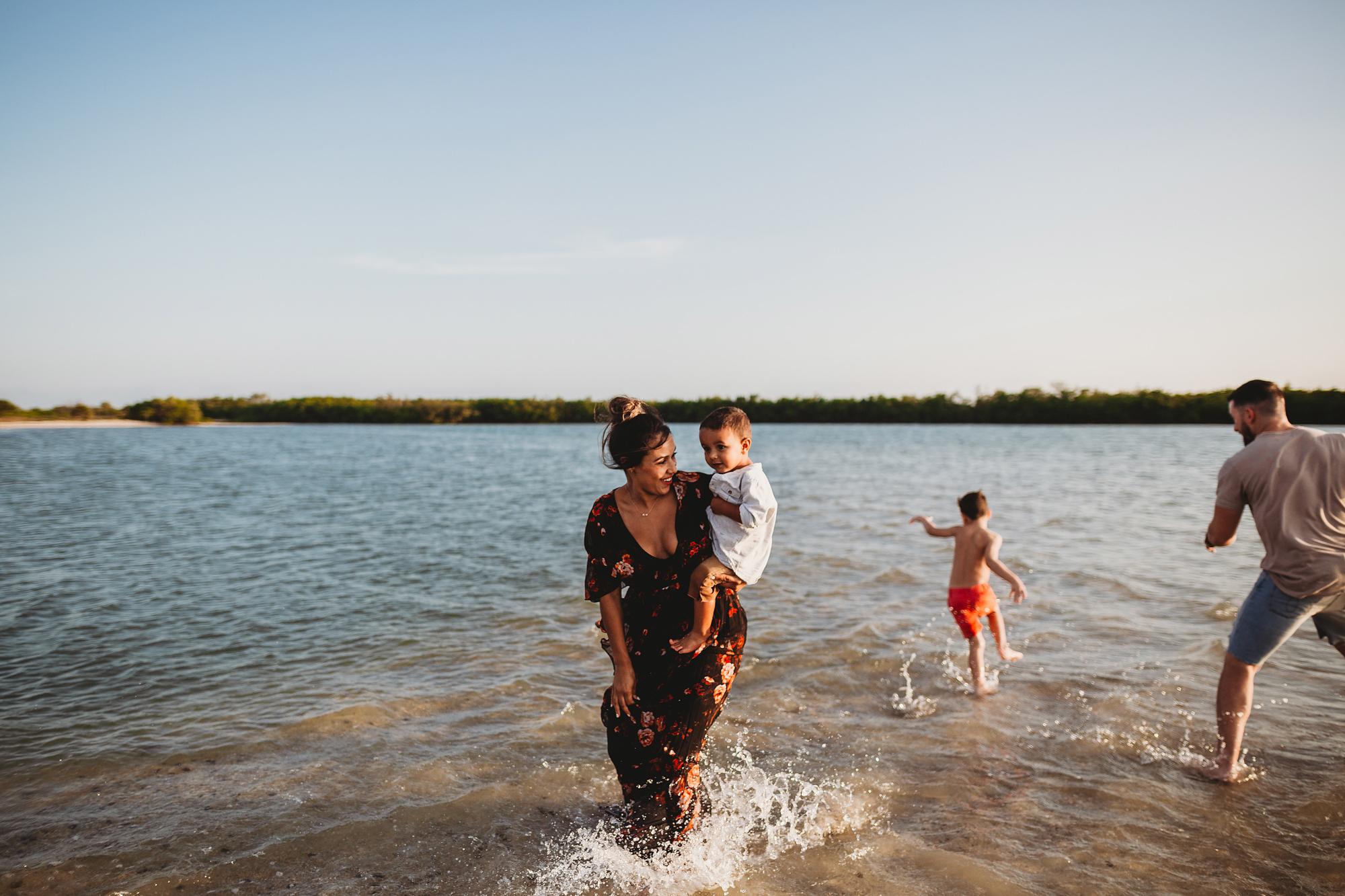fun family beach photos, lifestyle family photographer tampa