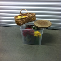 0110: Small Plastic Box of Small Mirrors, Imitation Flowers, Cheese Plates