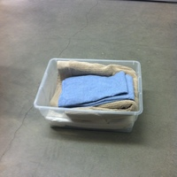 0119: Small Plastic Box with Assorted Small Towels