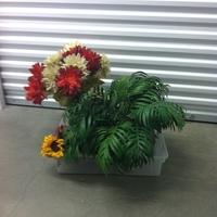 0121: Small Plastic Bin with Imitation Plants/Flowers