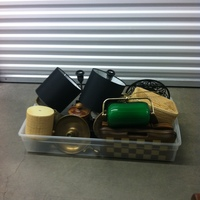 0122: Small Plastic Bin of Assorted Glass/Ceramic Accessories and Lamps