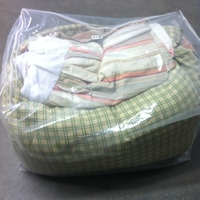 0148: Plastic Zip Bag with Comforter and Sheets