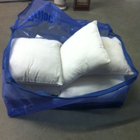 0158: Blue Plastic Zip Bag of Small White Pillows