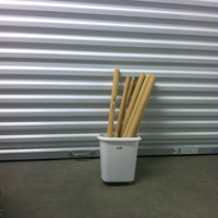 0181: Small White Trash Can with Wood Table Legs