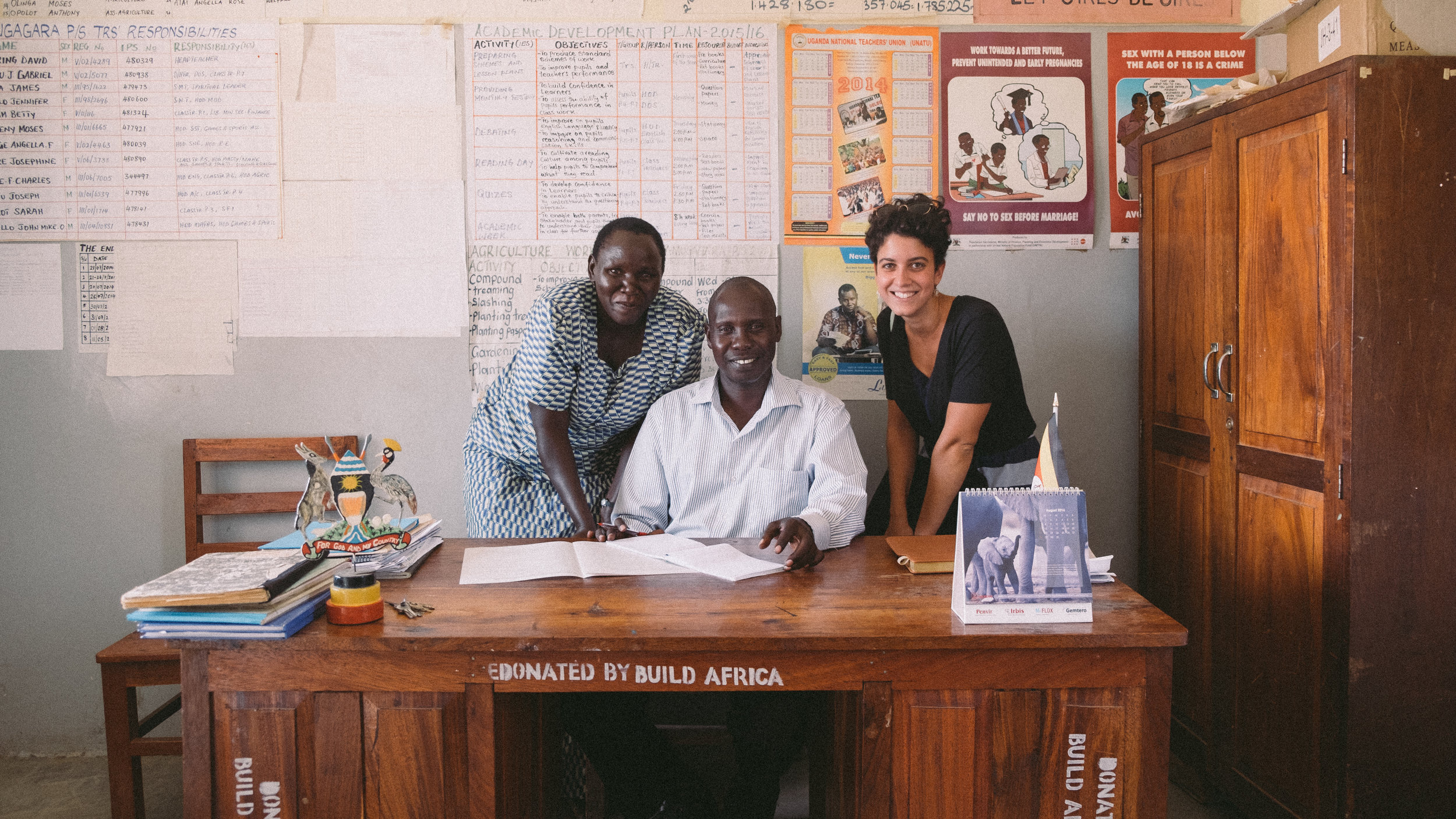 Each time we've filmed for Build Africa there has been a formal meeting with the headmaster and their staff before shooting begins. Here's Arianna with the Headteacher and one of the teachers, Jennifer.