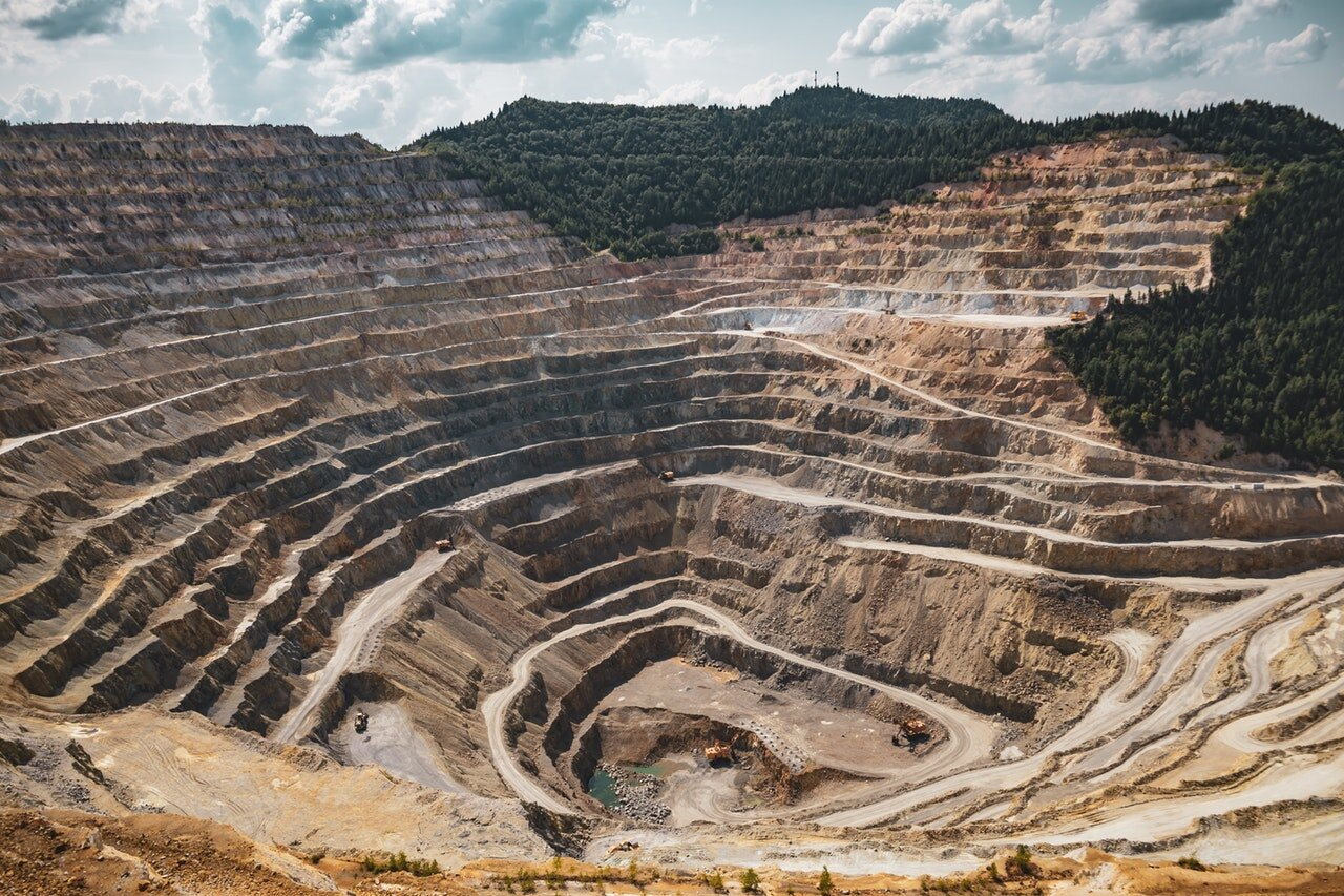 Mining remains a great metaphor because mines are both beautiful and horrific .