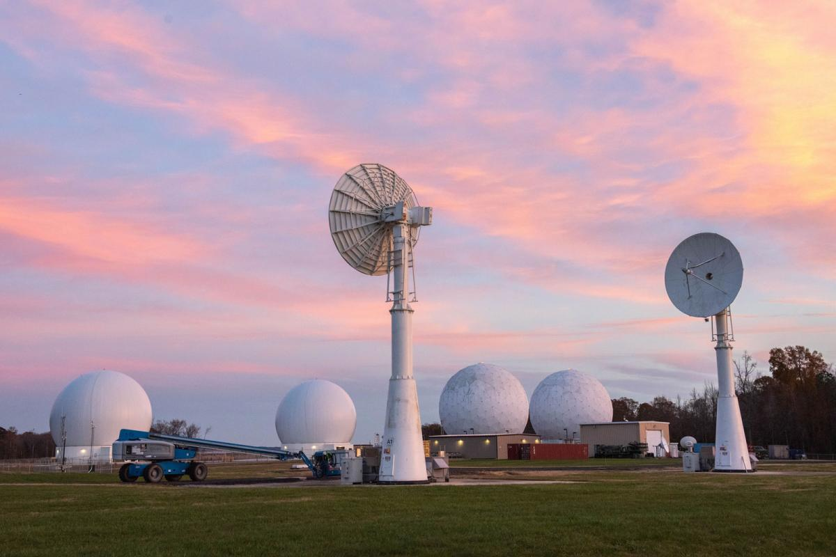 Blossom Point Tracking Facility antennas pointed skyward at sunset. NRL Photo by Emanuel Cavallaro.