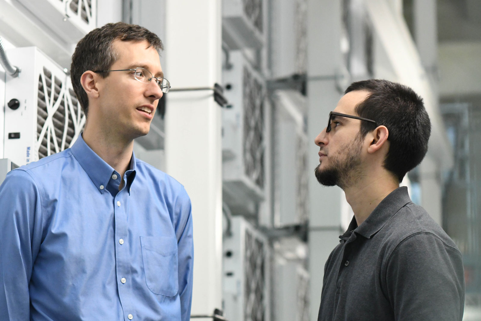 U.S. Naval Research Laboratory Aerospace engineers Evan Ward (left) and Greg Carbott (right). NRL Photo by Emanuel Cavallaro.