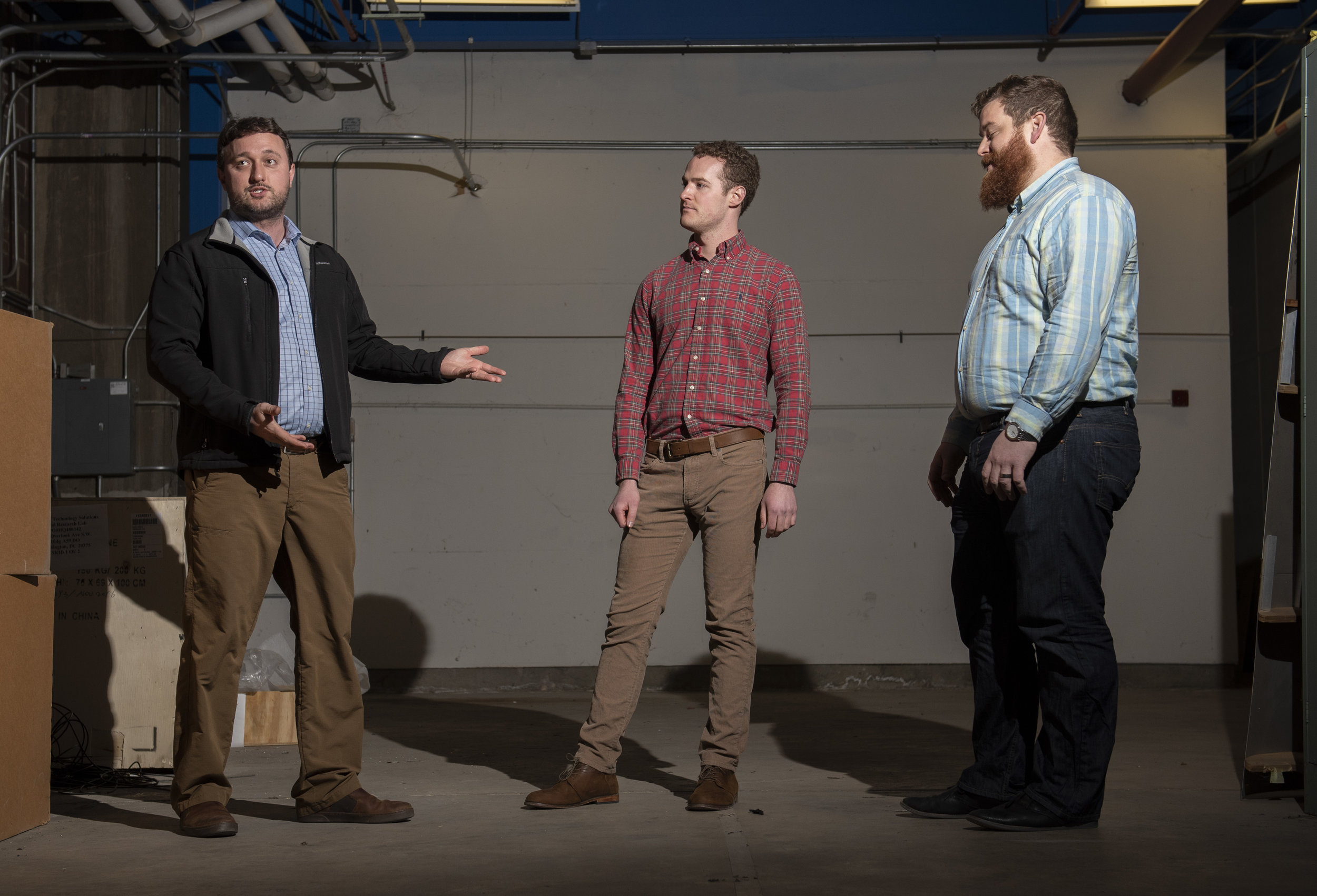 Mechanical engineers Jesse Maxwell (left), Evan Rogers (center) and Austin Phoenix (right) stand in a space that will soon be home to a new wind tunnel dedicated to hypersonics research. (Photo by Jonathan Steffen)
