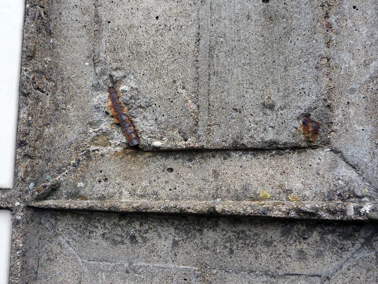 Rostig armering som sprängt sönder betongen