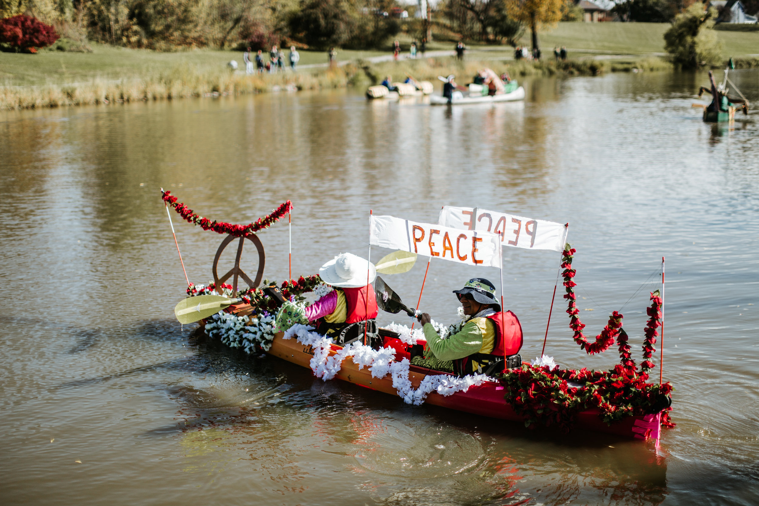 Colorful floral design and messages of peace won this kayak the highest award: the golden paddle. Photos by Friesen Photography.