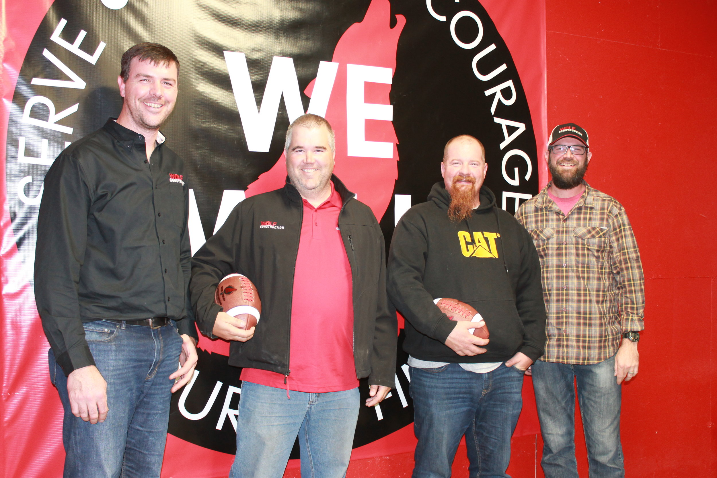 November 2017 Game Ball Recipients: The most tenured team member at Wolf Construction, Greg Goeser is a Framing Superintendent. Relentless is a word that can easily be used to describe Greg. He's relentless about finishing a job well and determined that those around him should be also. He's relentless about his family, and funny enough, relentless about travel and charity.  Minnesota Framing Superintendent Jason Potvin has been with Wolf Construction since 2010 when he started as carpenter. Crews, subs, general contractors, and fellow Wolf Construction employees are humbled by Jason's work ethic and ability to get tough jobs done. Jason is focused and intense about finishing. He's a planner and a soft spoken leader. The dad of three active boys, he has no free time! Pictured: R. Vandis, G. Goeser, J. Potvin, J. VanDis