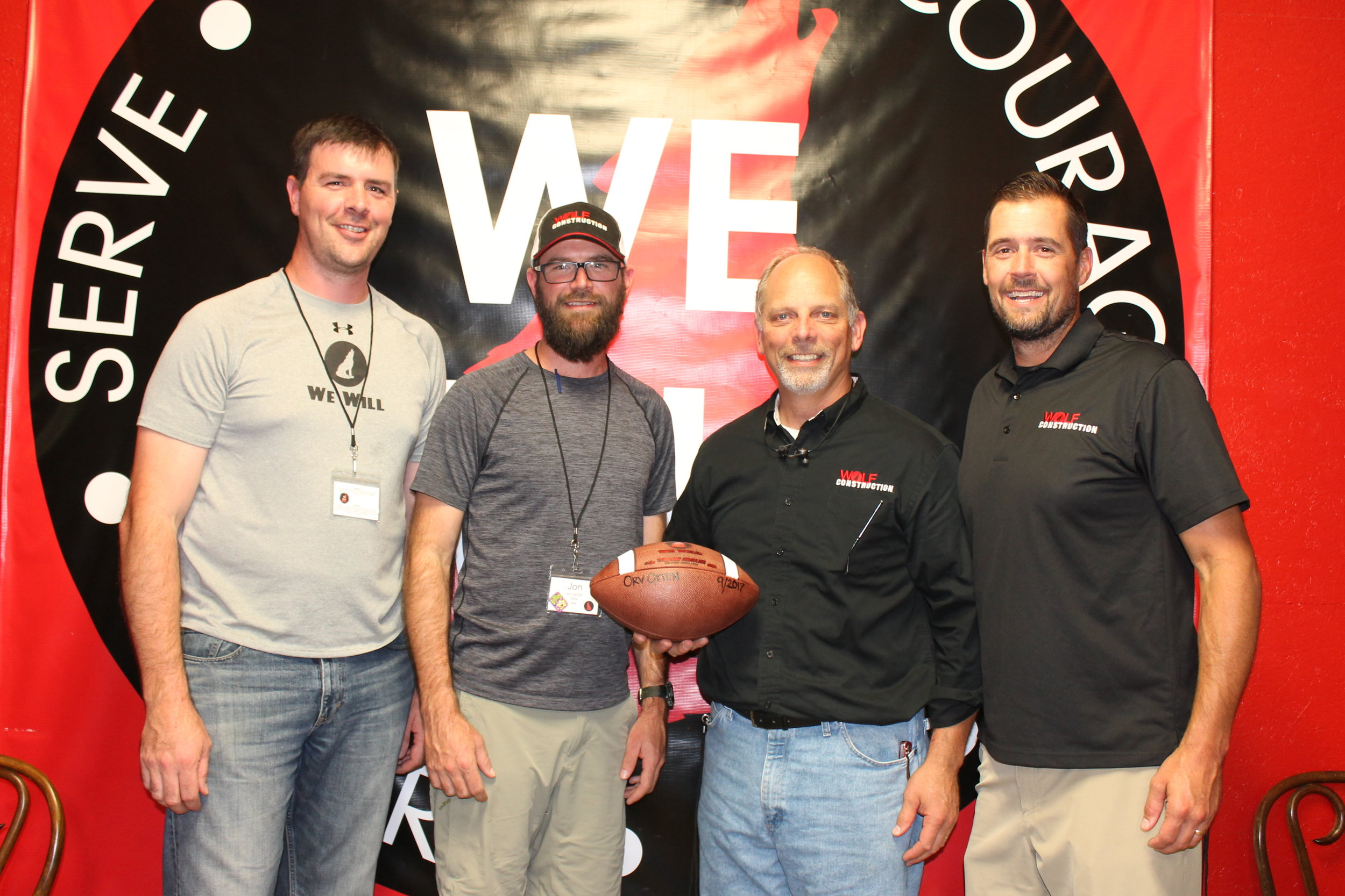 "Presenting the Game Ball to Orv Otten in September 2017 was an easy decision. Orv, respectfully known to many as ""Coach"" is the Director of Field Personnel for Wolf Construction. Hired in 2015, Orv has served as the company Recruiting, Training and Retaining expert for 3 years. Recently, he has taken on the challenge of Director of Field Personnel, seeking to spend more time with the field team, identifying and providing training and support to their skills.  A proud grandpa of two grandsons, Orv and his wife live in Ankeny. He enjoys football, family, and is an active JOPPA volunteer. Pictured: R. VanDis, J. VanDis, O. Otten, B. Hoch"