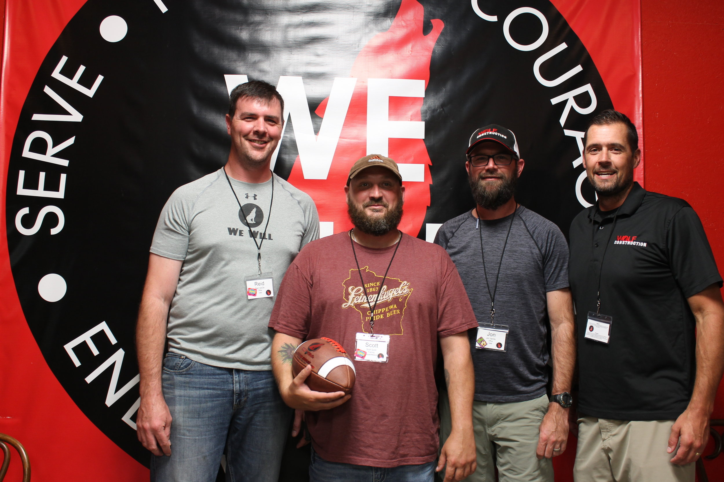 """Framing Crew Lead, Scott Quick is based in Kansas City and has been with Wolf Construction since 2015. He was awarded the Game Ball in September of 2017. Scott has embraced the We Will's of the company, is an eager learner, and comes to work each day with a """"yes-face"""". Most recently, he has been an integral part of one of the largest projects in the company's history by taking on the task of quality assurance and seeing to it that our scope of work was finished. Scott continues to learn the ways of the company and strives to be the best he can be. Pictured: R. VanDis, Scott Quick, J. VanDis,, B. Hoch"""