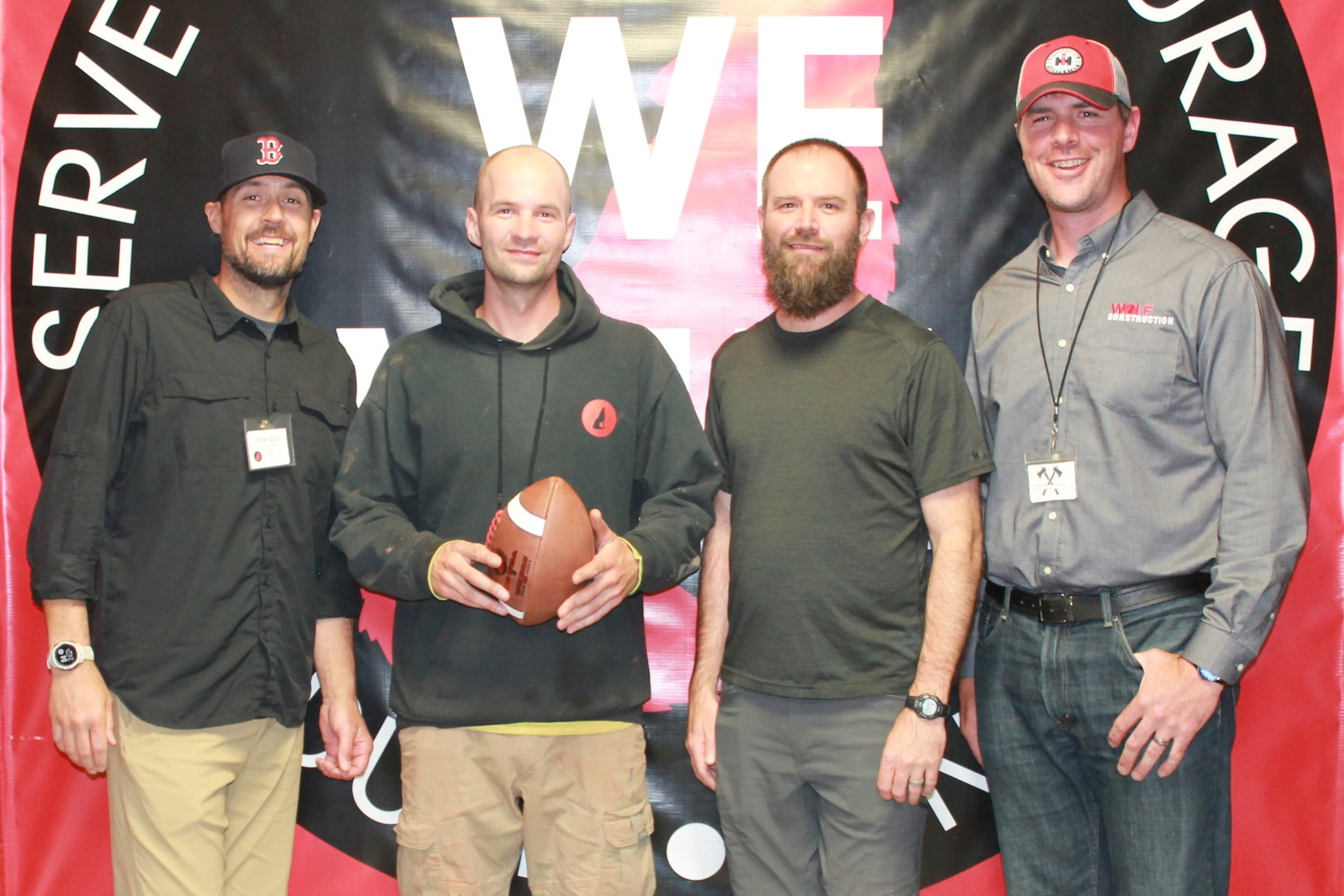 Chris Potvin has shared his encouraging attitude with Wolf Construction since 2015. The ever positive framing foreman in the Minnesota Division is known for his work ethic, communication style and true team attitude. The busy dad of 4 kids, Chris has no free time.  Wolf Construction was honored to present Chris with the Game Ball in May, 2019.    Pictured: B Hoch, C Potvin, J VanDis, R VanDis