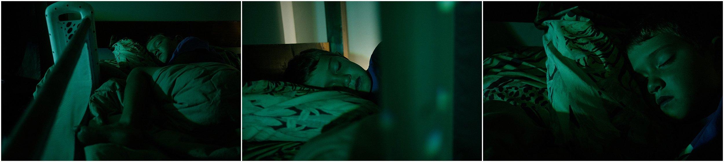 little boy sleeping in green light
