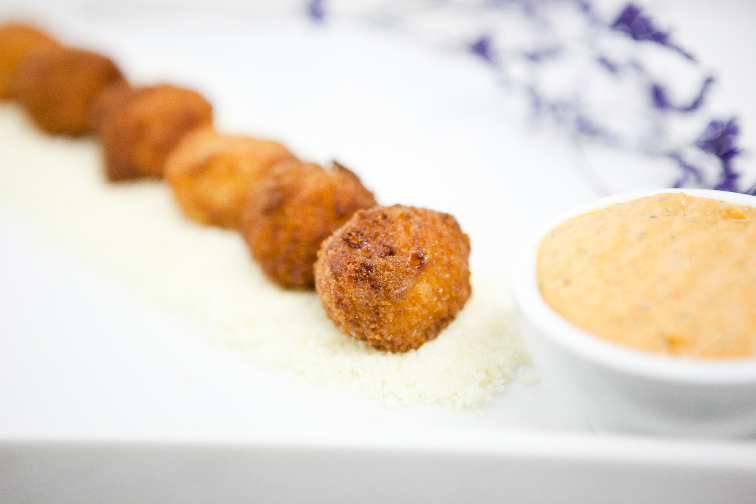 Mac and Cheese Fritters served with a roasted red pepper dip