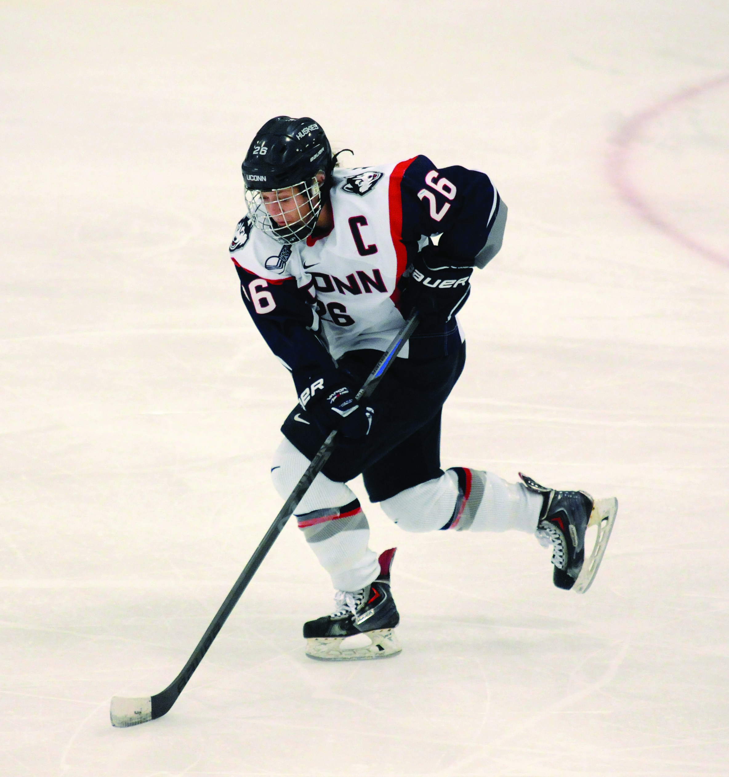 UConn senior captain Sarah MacDonnell skates in a game against the University of New Hampshire on Feb. 28, 2015. She is finishing up what has been a stellar career at UConn. (Santiago Pelaez/The Daily Campus)