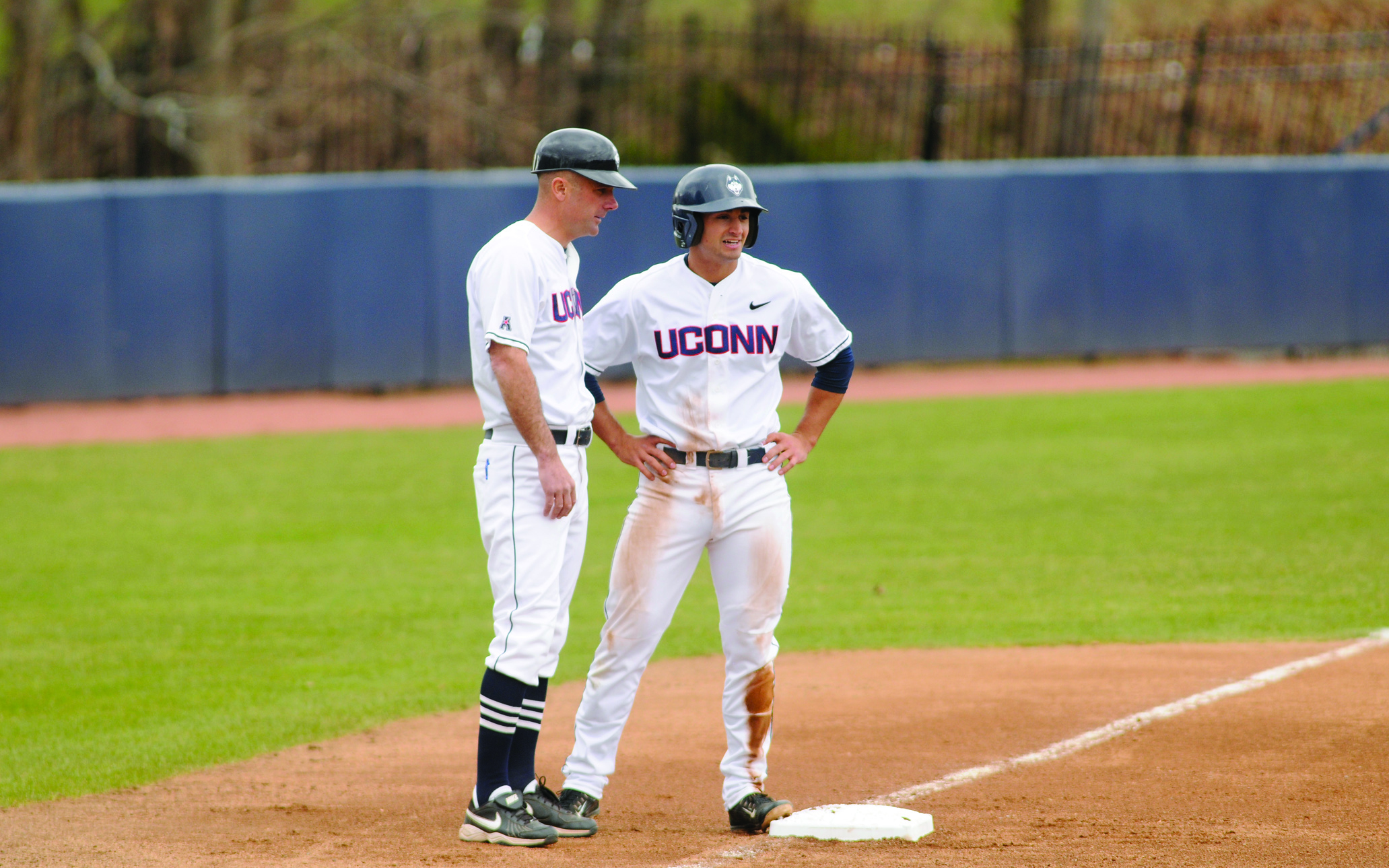 Former UConn infielder Vinny Siena (right) stands with head coach Jim Penders at third base during a game at J.O. Christian Field last spring. Siena was selected in the 14th round of this summer's Major League Baseball draft by the New York Mets. (Brad Watson/The Daily Campus)