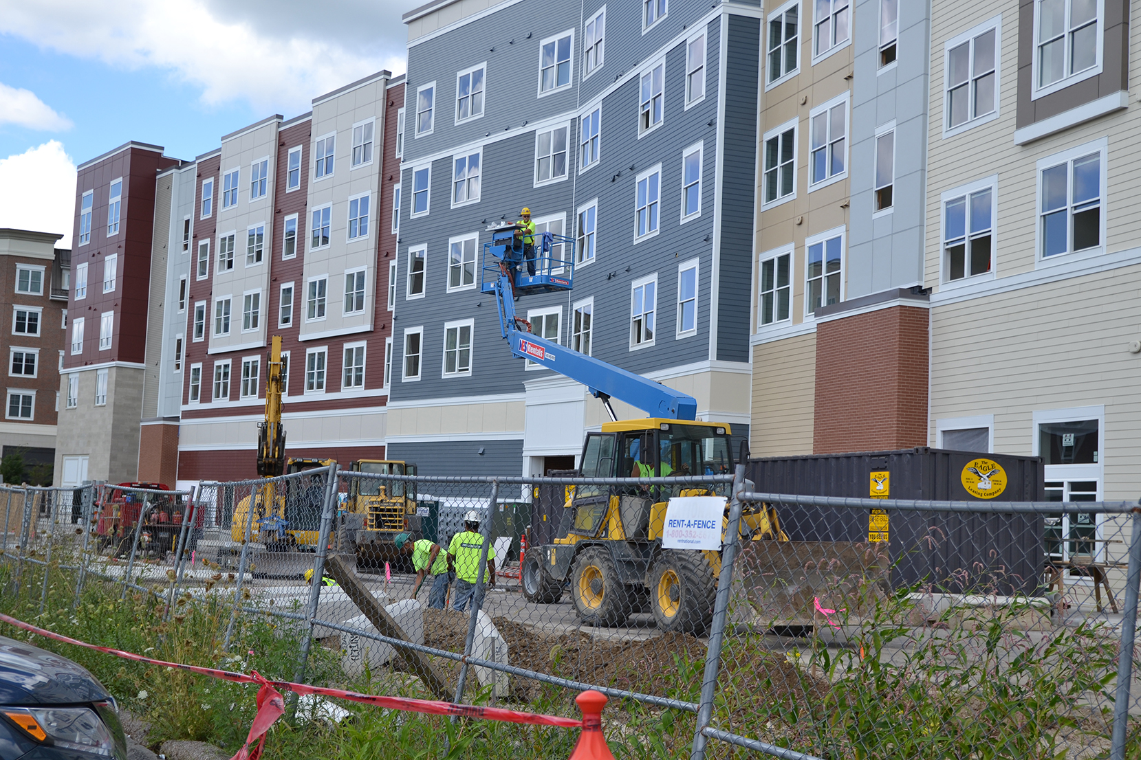 Construction crews are seen at The Oaks on the Square apartment complex in Storrs Center on Aug. 27, 2015. UConn students still awaiting apartments will be commuting or staying in hotels until the construction is completed.(Amar Batra/The Daily Campus)