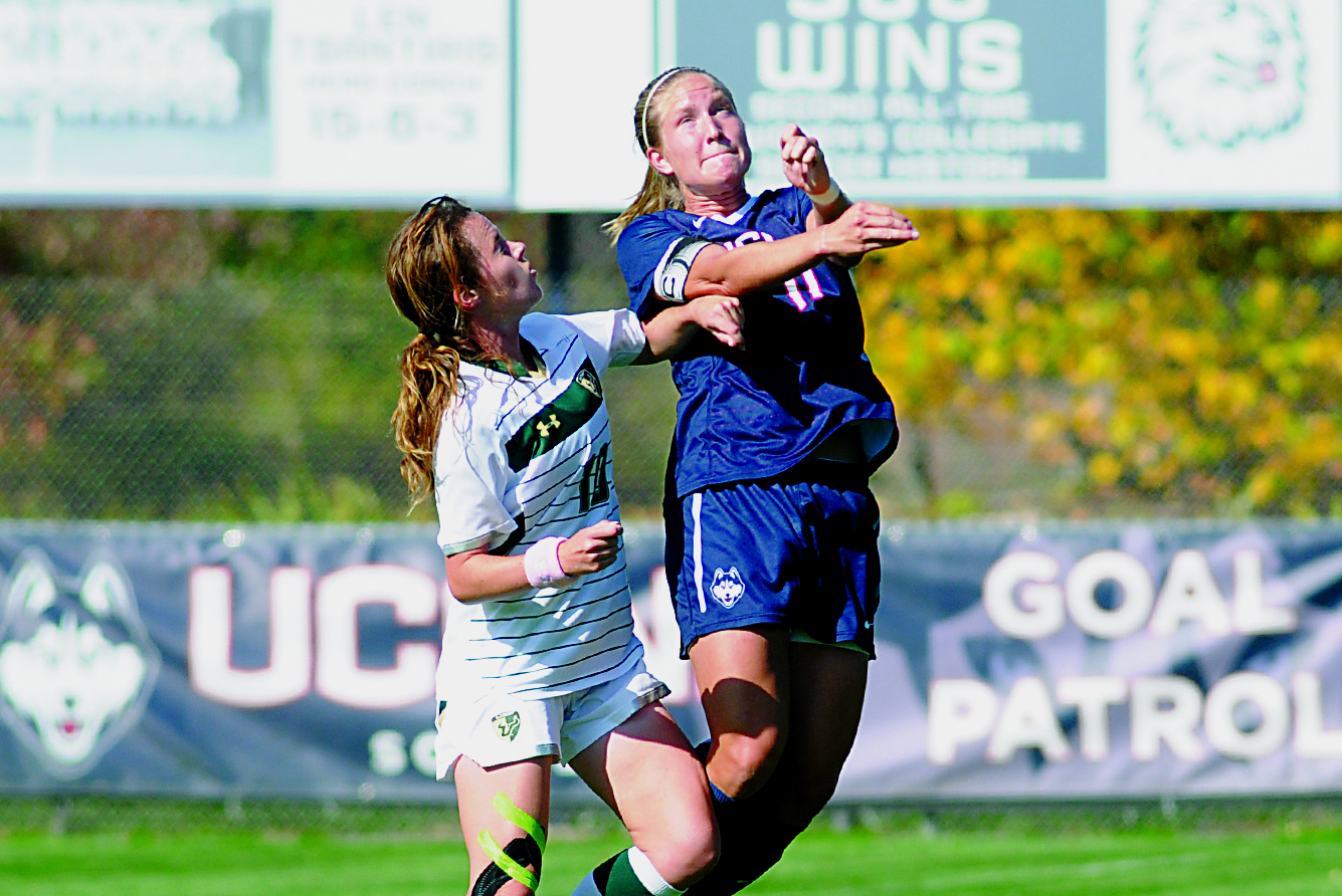 A UConn women's soccer player goes up for a header last season against South Florida at Joseph J. Morrone Stadium on Oct. 17, 2014. The Huskies defeated Navy 4-2 on Sunday to improve to 3-0 this season. (File Photo/The Daily Campus)