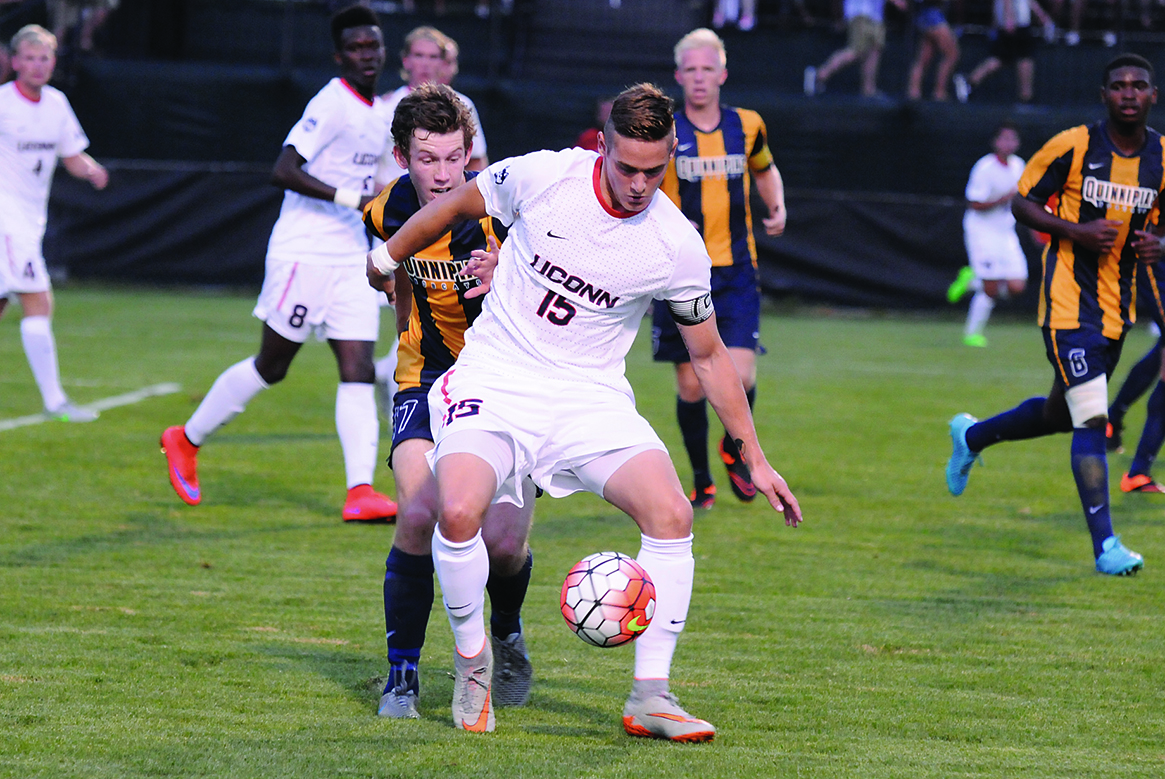 UConn junior defender Jakob Nerwinski holds off a Quinnipiac player at Joseph J. Morrone Stadium in Storrs, Connecticut on Aug. 31, 2015. The Huskies drew the Bobcats 0-0, the team's second consecutive scoreless draw. (Amar Batra/The Daily Campus)