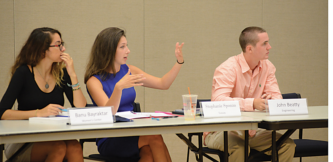 Towers Residence Hall Senator Stephanie Sponzo (center) speaks during the Undergraduate Student Government's first Senate meeting of the year in the UConn Student Union on Sept. 2, 2015. (Jason Jiang/The Daily Campus)