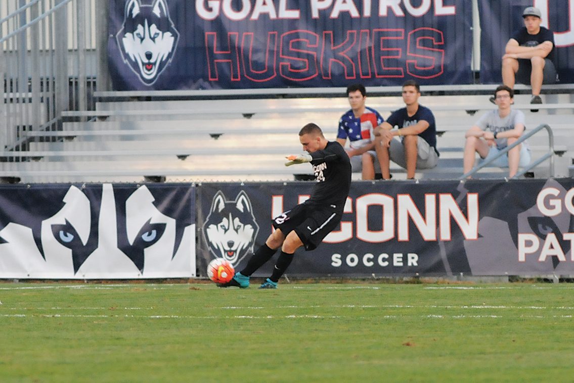 UConn men's soccer goalie Scott Levene kicks the ball downfield during the Huskies' game against Dartmouth on Friday, Sept. 4, 2015. While the Huskies have yet to score a goal this season, Levene has led the backline to three consecutive shutouts to open the 2015 campaign. (Amar Batra/The Daily Campus)