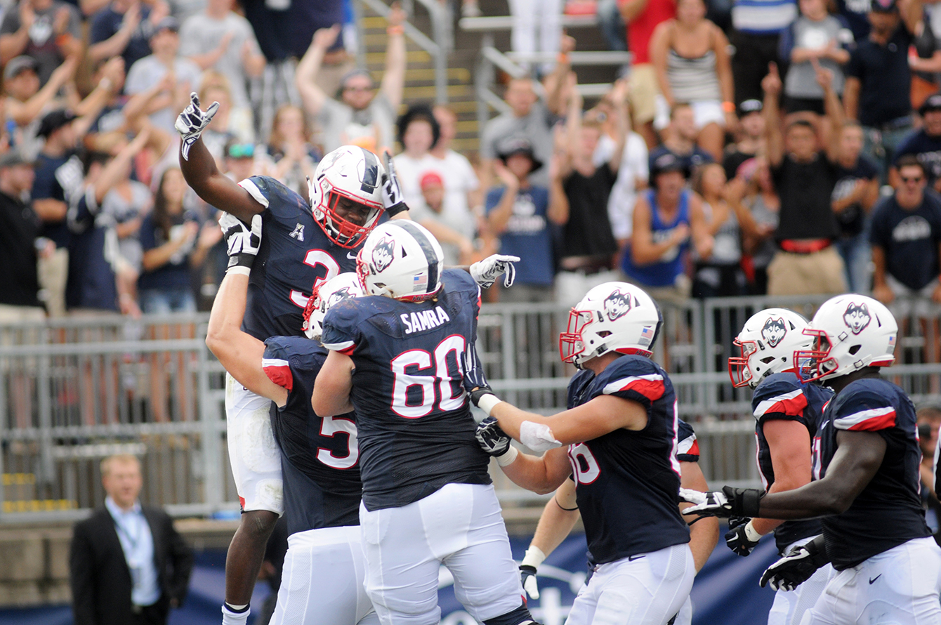 UConn running back Ron Johnson (3) celebrates with his team after scoring a 10-yard rushing touchdown in the second quarter to shorten Army's lead to one point. Johnson, a sophomore, finished the game with 39 yard rushing on 18 attempts. (Bailey Wright/The Daily Campus)
