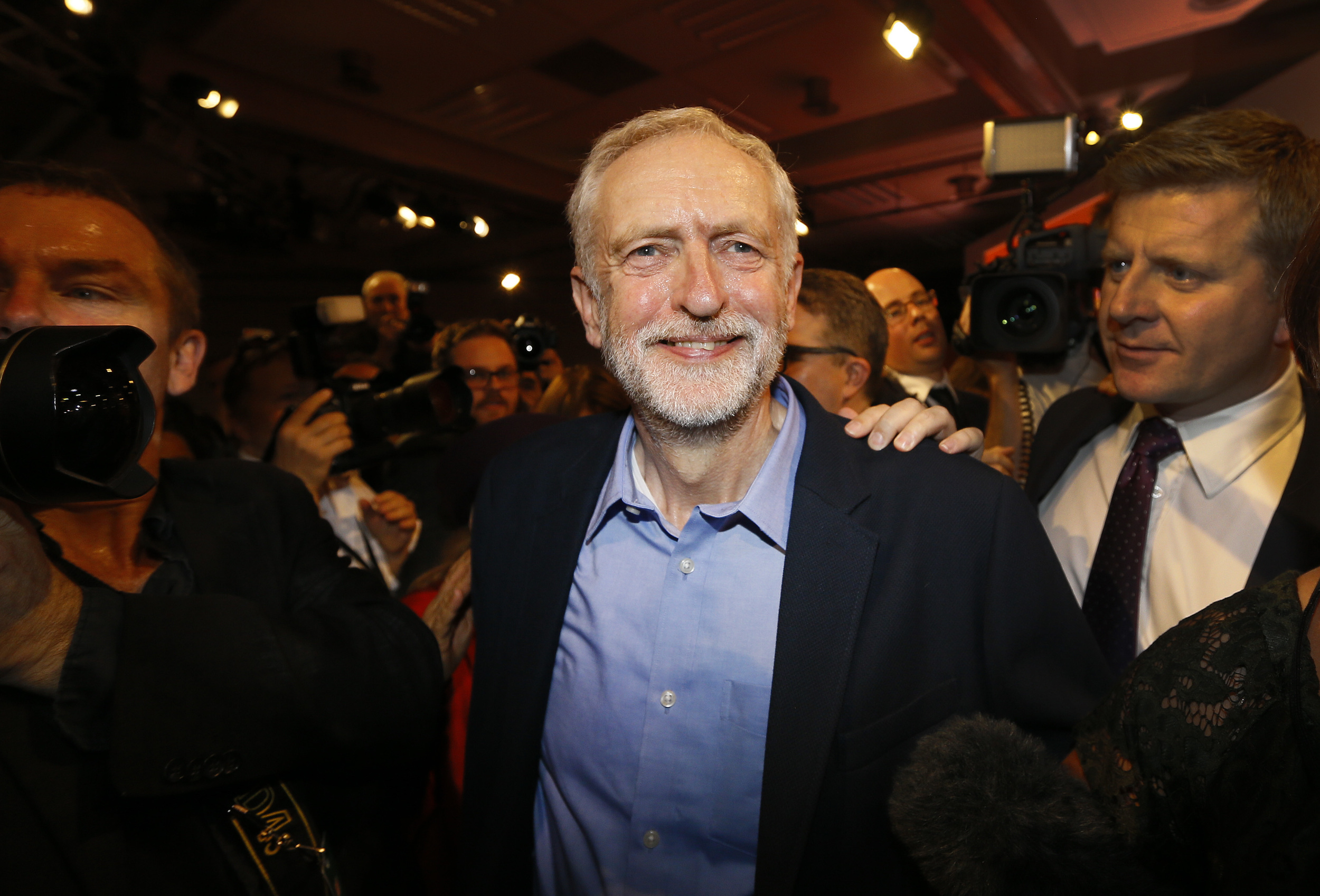 Jeremy Corbyn smiles as he leaves the stage after he is announced as the new leader of The Labour Party during the Labour Party Leadership Conference in London, Saturday, Sept. 12, 2015. Corbyn will now lead Britain's main opposition party. (Kirsty Wigglesworth/AP)