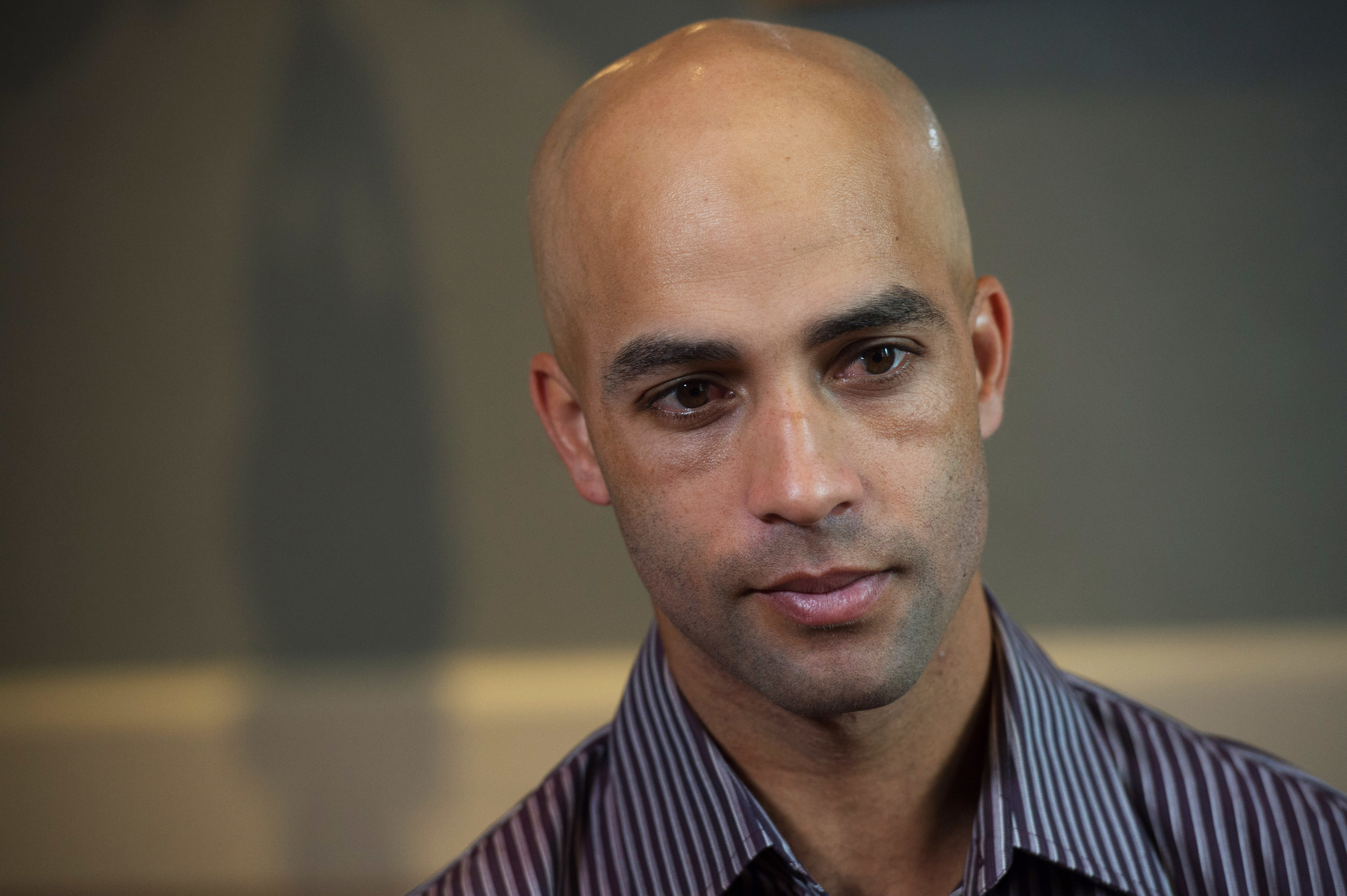 Former tennis star James Blake discusses his mistaken arrest by the New York City Police Department during an interview, Saturday, Sept. 12, 2015, in New York. Video surveillance released Friday of the mistaken arrest shows a plainclothes police officer who has a history of excessive-force complaints grabbing Blake by the arm and tackling him to the ground. (Bryan R. Smith/AP)