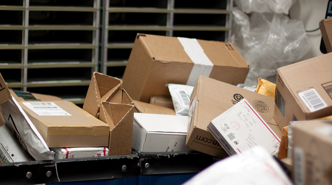 In this photo, packages are pictured in a UConn mail room. The university has received about four times as many packages as usual this fall, university spokesperson Stephanie Reitz said. (Mei Buzzell/The Daily Campus)
