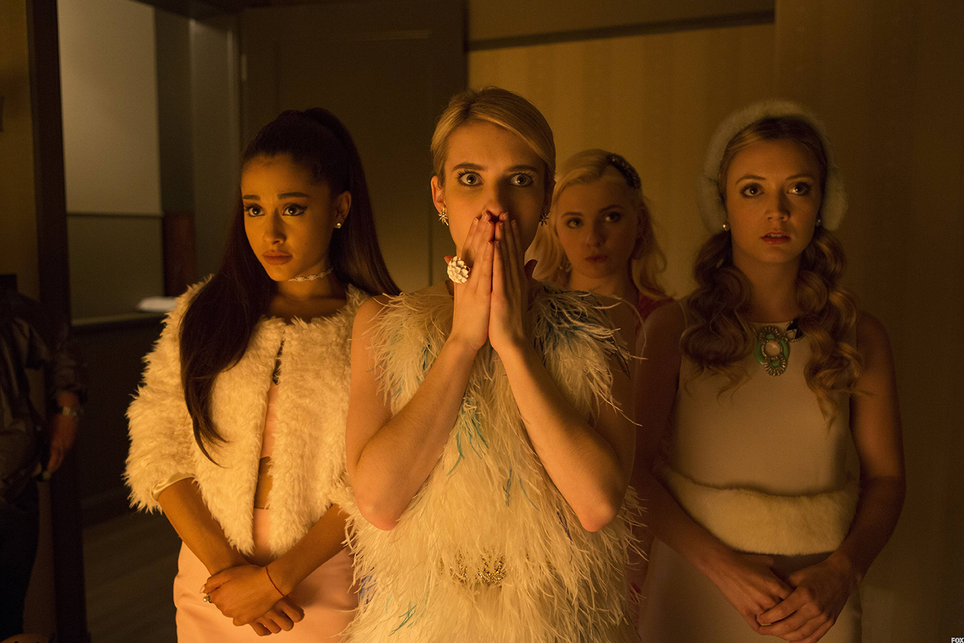 """(From left to right) Ariana Grande, Emma Roberts, Abigail Breslin and Billie Lourd make up """"the Chanels,"""" a clique of disproportionate power operating within their murder-stricken sorority. """"Scream Queens"""" is written by Ryan Murphy of """"American Horror Story"""" and Glee."""" It debuts Sept. 22 on FOX. (Courtesy/Fox)"""