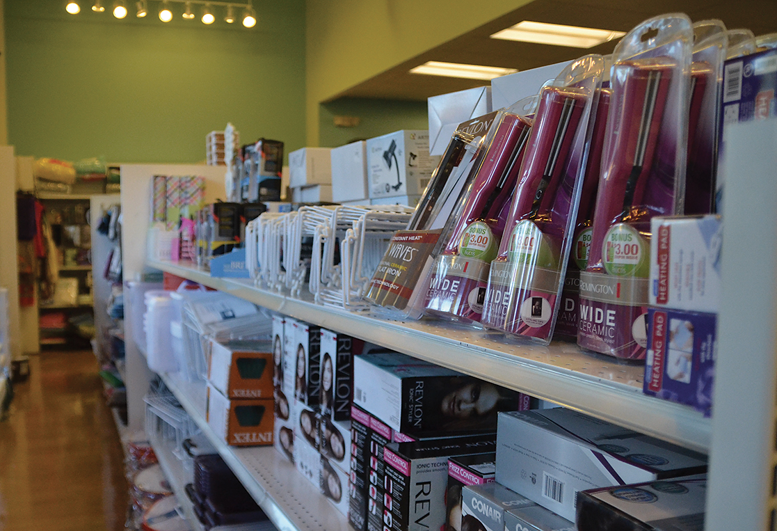 In this photo, a shelf containing hair products and other dorm-related items is pictured in the UConn Co-op in Storrs, Connecticut.The Co-op had 20,276 customers during move-in weekend, Aug. 28 through Aug. 31. (Amar Batra/The Daily Campus)