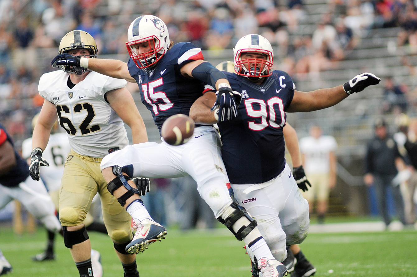 UConn football sophomore linebacker Luke Carrezola (15) and redshirt senior defensive lineman Julian Campenni (90) are pictured during the Huskies' game against Army at Pratt & Whitney Stadium at Rentschler Field in East Hartford, Connecticut on Saturday, Sept. 12, 2015. (Bailey Wright/The Daily Campus)