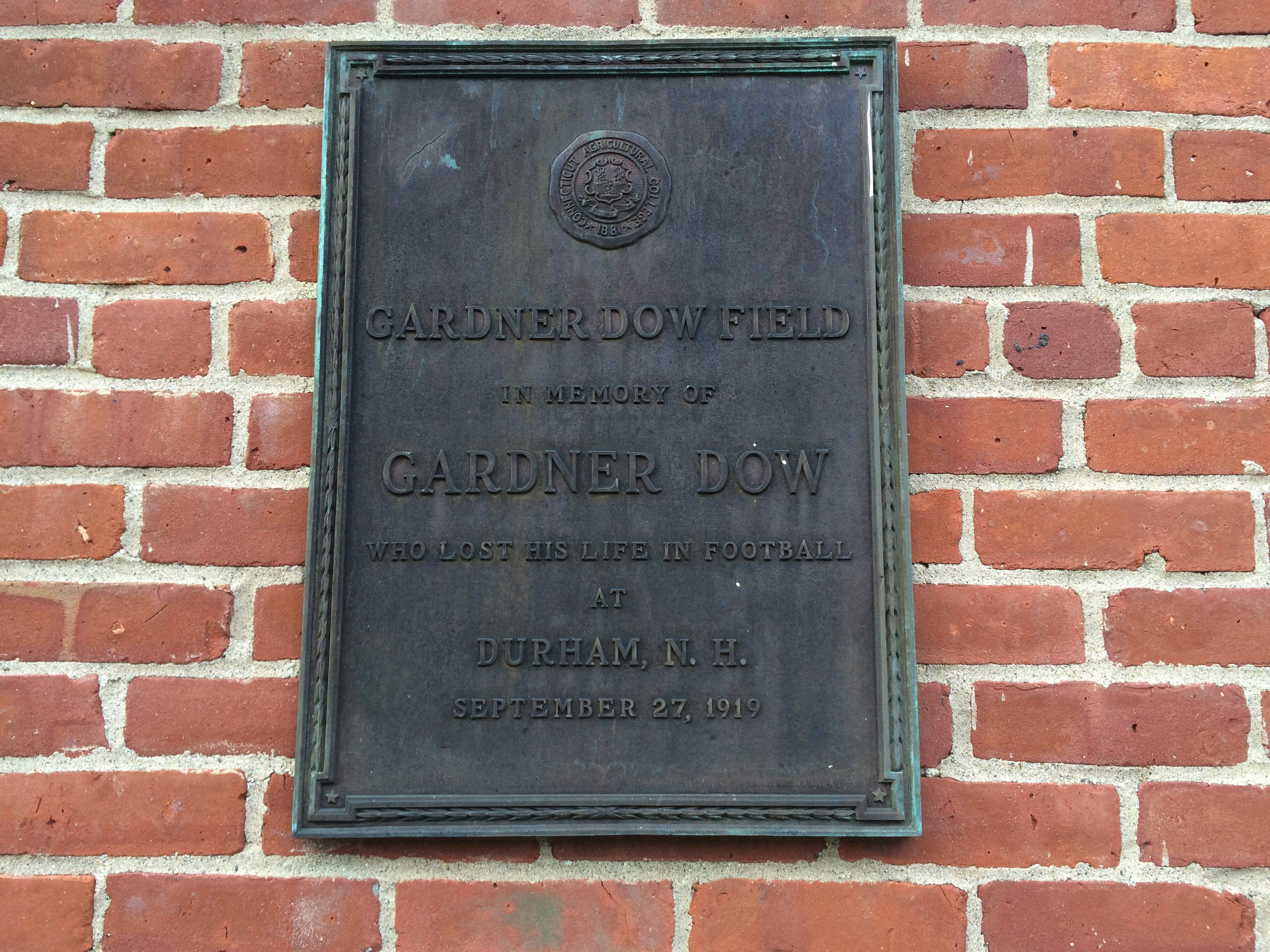 In this photo, the plaque memorializing Gardner Dow Field is seen behind the Hawley Armory on the UConn campus in Storrs, Connecticut. (Courtesy/Dan Madigan)