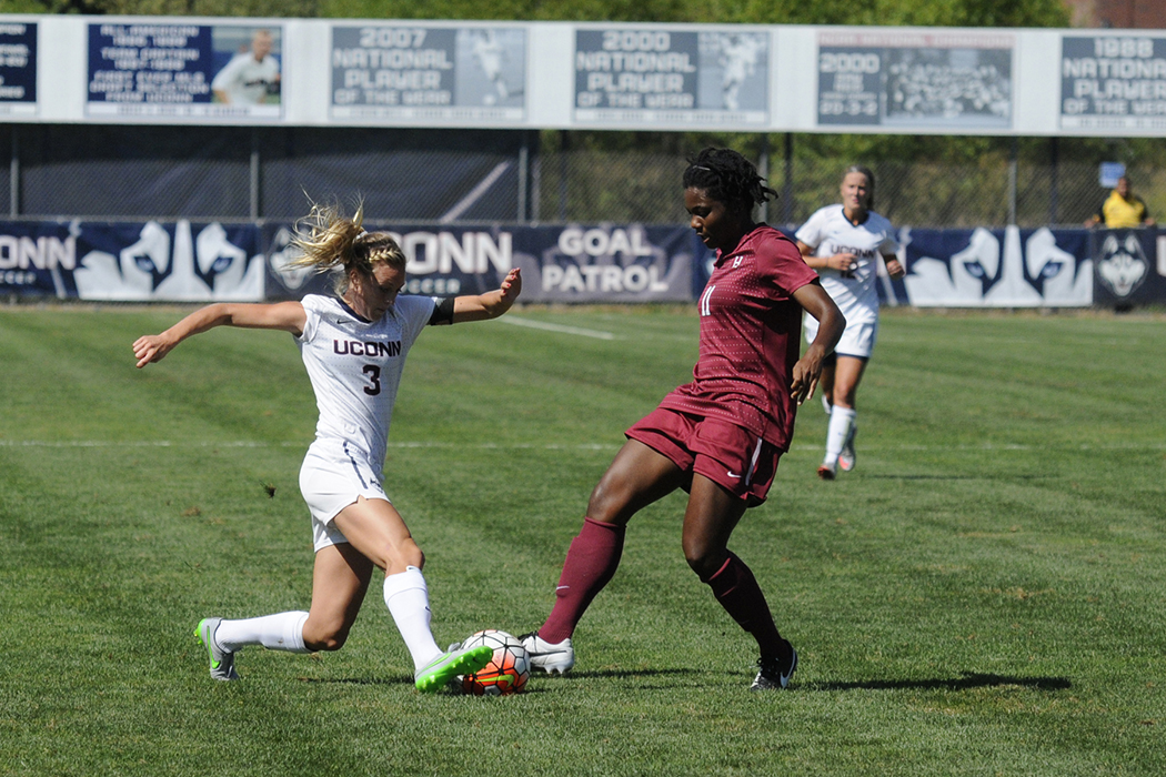 UConn junior forward Rachel Hill fights for the ball during the Huskies' game against Temple at Joseph J. Morrone Stadium on Friday, Oct. 2, 2015. (Amar Batra/The Daily Campus)